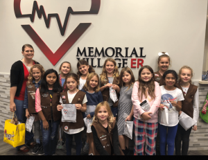 Local Girl Scouts First Aid badge class host by Memorial Village ER